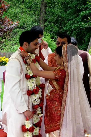 Var mala exchange of garlands at Indian wedding photo by k money on