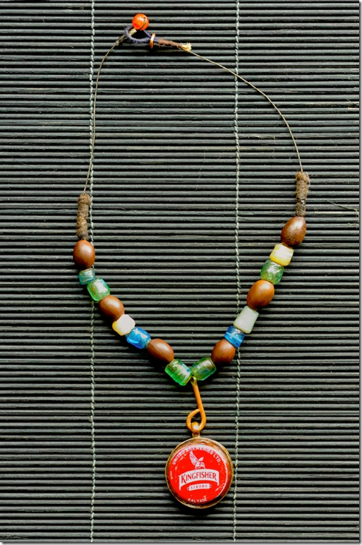 Amman Rashid necklace (2011) Kingfisher beer bottle cap, lotus seed beads, glass beads, copper wire, cotton thread and carnelian agate, approx 14 inches, photo: Anil Advani