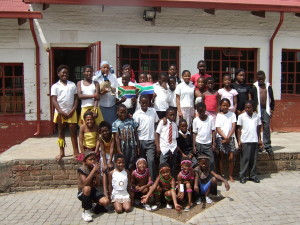 Some students of Belle Primary School with Susu, the emu