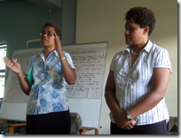 Representatives of the ANZ Bank discussing micro-finance