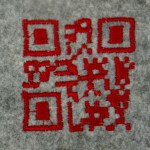 "Embroidered QR code from Kuusk, Kristi, Stephan Wensveen, and Oscar Tomico. 2014. ""Crafting Qualities in Designing QR-Coded Embroidery and Bedtime Stories"""