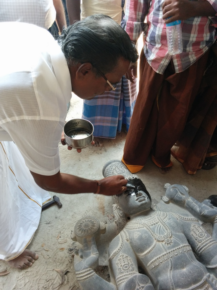 Freshening up a statue with coconut oil